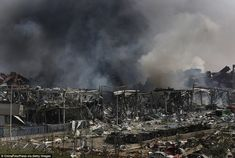 Black: Fire and smoke continues to rise at the site of a massive explosion at a warehouse in the Binhai New Area  in Tianjin today