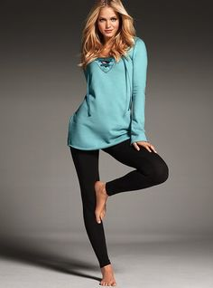 Teal lace-up tunic with dark leggings