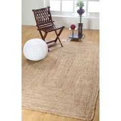 Artisans hand braid our rug from naturally smooth and durable jute, a richly varied natural fiber that feels soft and resilient underfoot. The yarns are spun by hand and left undyed to highlight their