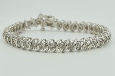 "14 KT White Gold Diamond Tennis Bracelet, 18.5GRM, 61/2"" long,Total Apprx 4.0CTW starting under a thousand is a steal!"