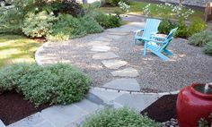 Green garden ideas with plants surrounding, blue wood chairs, water fountain, stone way, gravel patio