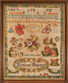 What an exquisite sampler!The Lion,St Bernard,Flowers,Big Butterfly,Dove,& even what seems to be a tiny White Kitten chasing a Butterfly at the bottom..all are truly fabulous.French samplers seem to be the loveliest.Crafted by Louise Dumet, San Jose, California, 1876