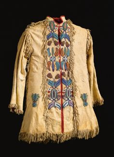 Crow beaded and fringed hide scout jacket stitched on the front, back of the shoulders and cuffs, with stylised curvilinear motifs, panels of short cut fringe overall. Native American Clothing, Native American Artifacts, Native American Beadwork, Native American Fashion, Native American History, Native American Indians, Indian Beadwork, Style Indien, Crow Indians