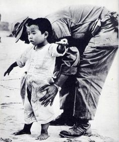 korean refugee child being searched for weapon