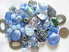 Buy it now at our Etsy store! Mixed Beads 48 Pcs Violet Blue Murano Style Glass by MixedBeadBags