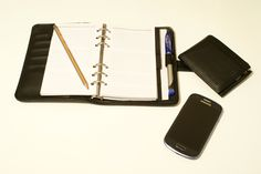 Diary, wallet, pencil and smartphone samsung galaxy S3 mini on the desk. Our photographs are FREE and you can use them for web sites, mobile apps, image Placeholders, all private or commercial works etc. If you have any questions, write to info@freephotodb.com.