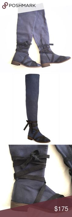 "Free People West End Wraparound Boot Blue Size 39 NEW without tags. Size 39 Euro (approximately 8-9 US). Contrast black leather straps wrap the shaft and square toe of an over-the-knee blue boot set on a slight stacked heel. 1 1/4"" heel (size 39). 23"" boot shaft; 14"" calf circumference. Partial side-zip closure. Leather upper, lining and sole. By Free People. Free People Shoes Over the Knee Boots"