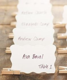 Let guests locate their seats in a creative way. Clip a miniature clothespin to the bottom of each paper to create the base for a rustic escort card display.