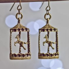 carousel earrings - bronze horse amusment parks. $0.99, via Etsy.