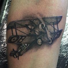 Biplane tattoo