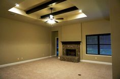 Living room, open concept living, brick fireplace, pop-up with stained beams #mcbeehomes