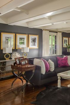 Love these dark gray walls with gold and fuchsia accents
