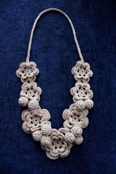 Crochet flower necklace. One day I am going to learn how to make this.