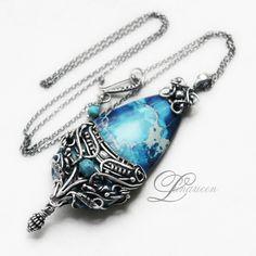 IGALLMANARESHI by LUNARIEEN.deviantart.com on @deviantART Beautiful blue pendant