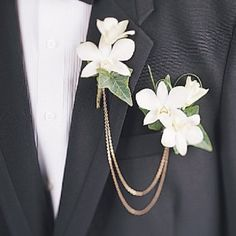 Two delicate buttonhole dendrobium orchids with a thin gold chain connecting them, one pinned to the lapel and the other a pocket boutonniere. Modern Wedding Flowers, Winter Wedding Flowers, Wedding Flower Arrangements, Floral Wedding, Orchid Boutonniere, Groom Boutonniere, Bridesmaid Flowers, Flower Bouquet Wedding, Prom Corsage