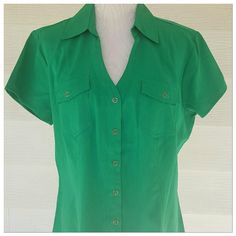 Kelly Green no wrinkle button down 24 bust 27 length. Kelly Green no wrinkle button down short sleeve top.  Beautiful shade of green.   Tailored shape. Cato Tops Button Down Shirts