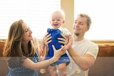 fun family portrait 9 month old baby laughing lifestyle photography
