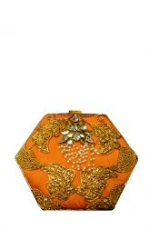 Meera Mahadevia's bright, bold clutch is a wonderful choice for traditional occasions such as a festival or wedding. The bag features raw silk on the front and brocade on the back, with gold leaf and kundan embroidery all over. Best paired with a tunic, saree or anarkali this clutch will beautifully complete your traditional look.