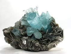 Aquamarine- (Beyrl)-  composed of beryllium aluminium cyclosilicate with the chemical formula Be3Al2(SiO3)6. ....The pale blue color of aquamarine is attributed to Fe2+ , hardness of 7.5–8,  Crystal systemHexagonal