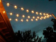 I love this look of lights over the deck. She gives directions on how she did it.