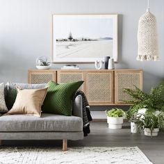 Decorating with Cane and Rattan Furniture and Decor — Mix & Match Design Company - Gorgeous woven door sideboard (cane) in a modern living room. Love the gray sofa with moroccan style rug and the oversized landscape art above the sideboard. Home Living Room, Living Room Decor, Living Spaces, Dining Room, Interior Design Living Room, Living Room Designs, Room Interior, Home Design, Living Room Inspiration