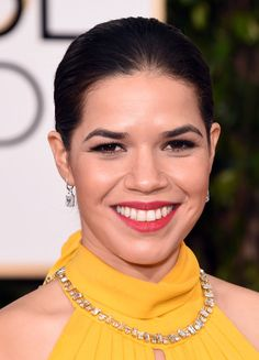 America Ferrera flashed her pearly whites with bright red lipstick that brought out the color of her yellow halter gown.