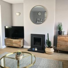 Lush living room - love all the plants and furniture. Such a relaxing space. Fireplace Tv Stand, Living Room Grey, Lush, Home And Garden, New Homes, House Inspirations, Space, Furniture, House Ideas