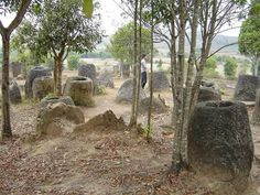 The Mysterious Plain of Jars, often referred to as an Asian version of Stonehenge, Xieng Khouang Plain, Laos (c.1 A.D.) thousands of megalithic stone jars made of sandstone, granite, or calcified coral are scattered around the plain and appear in clusters. They weigh up to 13 tons and are between 1 and 3 meters high. It has not been determined who built them or their purpose.