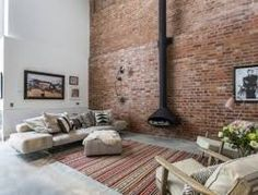This Victorian-era converted cooperage in Clerkenwell has been transformed into a modern home complete with a living wall by Chris Dyson architects Vintage Industrial Bedroom, Hanging Fireplace, Warehouse Home, Gravity Home, Piece A Vivre, Exposed Brick, Living Room Chairs, Family Room, Living Spaces