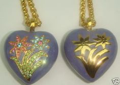 NO SILLY - YOU ONLY GET ONE.....I PUT THEM SIDE BY SIDE WITH ONE FLIPPED OVER SO THAT YOU COULD SEE THE DESIGN ON THE BACK SIDE AS WELL.....THE COLOR LOOKS A BIT OFF TO ME IN THE PICTURE - IT'S A TRUE LAVENDER ENAMELING....THE SWAROVSKI CRYSTALS ARE PAVE SET AND there ARE PERIDOT IN THE LEAVES - ROSE AND SAPPHIRE RHINESTONES IN THE FLOWERS....HIGH POLISHED GOLD PLATE.......THE CHAIN IS ONE OF THE NICEST PIECES I HAVE SEEN IN JOAN'S LINE - HEAVY DUTY BUT DELICATE AND IT MEASURES A WHOPPING 36…