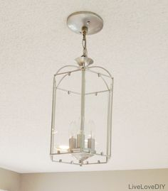 Ugly $5.00 brass chandelier is transformed into something delicate and airy with just a simple coat of silver paint.