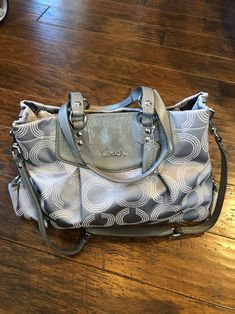 Used coach purse. A few stains and pen marks located in pictures. No wear on straps has a detachable longer strap. Vintage Coach, Bow Sneakers, Fenty Puma, Coach Purses, Buy Now, Stains, Louis Vuitton, How To Wear
