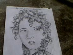 IT IS AN SKETCHING USING 3B , HB AND OTHER PENCILS. IT IS AN ART WHICH SPECIALITY IS THE CURLY HAIR OF THE LADY .