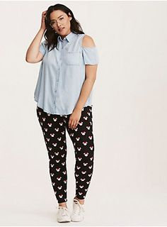 """We just can't get enough Minnie! Can't you tell with these leggings? The black knit is a second-skin fit, with an aww-dorable white Minnie Mouse head print that's been embellished with signature bows.28"""" inseamCotton/spandex"""