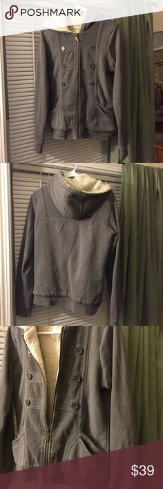 Billabong super warm hoodie, warm cozy lining inside. Perfect for keeping warm during the upcoming cold weather. Looks awesome . Two layered pockets on each side. Billabong Tops Sweatshirts & Hoodies