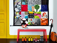 Handy handiwork. A wall organizer with pockets sewn from fabrics. See our how-to tips.