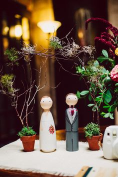 wooden cake toppers, photo by Mullers Photography http://ruffledblog.com/luciles-old-market-wedding #weddingideas #caketoppers