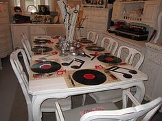 Love this table decor using records and sheet music for place setting whimsy