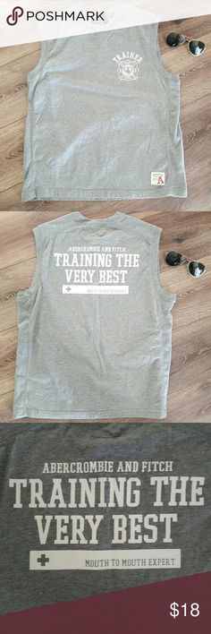 """*CLEARANCE* {Mens} Muscle shirt by Abercrombie Awesome gray and white muscle shirt. Perfect for summer! Has funny saying of """"Trainer. Training the very best... Mouth to mouth expert"""". 100% cotton. Measurements provided in pics above. From a smoke and pet free home. Fast shipping! Beach - Vacation - Fun - guy - spring - summer *IF YOU LIKE MY ITEMS, please FOLLOW ME to see NEW ARRIVALS that are added weekly* Abercrombie & Fitch Shirts Tank Tops"""