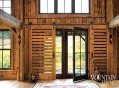 Sliding pocket doors in a renovated Sun Valley, Idaho, barn. Photo by David O. Marlow Barn Again | Mountain Living
