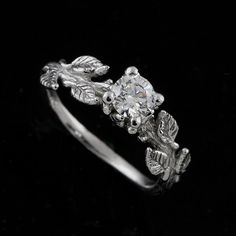 Delicate engagement ring with leaf detail.
