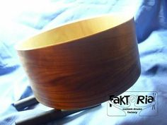 Wood snare drum shell.