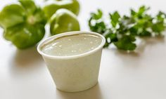 CREAMY TOMATILLO DRESSING  1 packet Hidden Valley Ranch salad dressing mix 1 cup mayonnaise 1 cup milk 2-3 tomatillos, remove husk, cut in 1/2 1 bunch of fresh cilantro (cut off most of stems) 1 generous tsp of minced garlic juice of 1 lime (I use two!) 1 jalapeno (I'm a wimp so I remove the seeds, leave them in if you like it SPICY!)  Throw it all in the blender and BLEND! Refrigerate.
