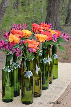 Make an Easy and Elegant Floral Centerpiece out of Wine Bottles! Need to do this for blog post this summer when all my flowers are in bloom