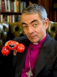 Rowan Atkinson poses with the three Red Nose options for 2013