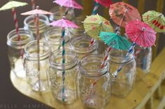 Drink umbrellas and mason jars. Cute idea for a sweet 16 luau party!