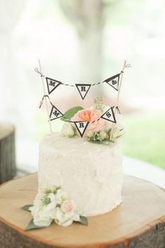 Cute Mr. & Mrs. wedding cake: http://www.stylemepretty.com/little-black-book-blog/2014/11/25/southern-chic-mountainside-wedding/   Photography: Jillian Michelle - http://www.jillianmichellephoto.com/