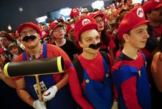 """Cosplayers dressed as character """"Mario"""" celebrate the 30th anniversary of """"Super Mario Bros."""" video games developed by Nintendo during the Gamescom 2015 fair in Cologne, Germany August 6, 2015. The Gamescom convention, Europe's largest video games trade fair, runs from August 5 to August 9. REUTERS/Kai Pfaffenbach"""