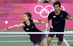 Japan's Reiko Shiota, left, returns the shuttlecock as teammate Shintaro Ikeda looks on during their mixed doubles match against Poland's Robert Mateusiak and Nadiezda Zieba of the badminton competition at the 2012 Summer Olympics, Tuesday, July 24, 2012, in London.
