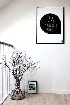 Large glass vase with branches / black and white wall decoration